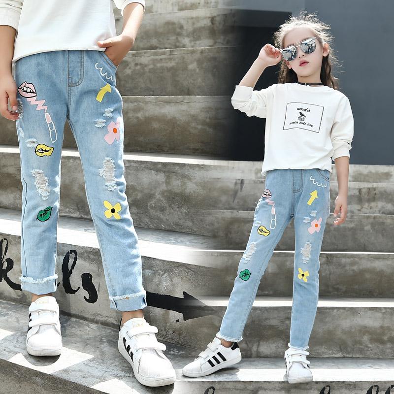 女童牛仔裤中大童女孩秋款修身弹力裤时尚涂鸦破洞牛仔长裤子
