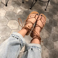 韩国夏时尚交叉绑带网红凉鞋女波西米亚平底夹脚沙滩罗马凉鞋
